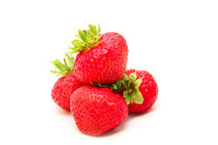 Ripe strawberries isolated on white. Four beautiful ripe strawberries isolated on white Stock Photos