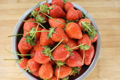 Ripe strawberries in metal dish. Red ripe strawberries in metal dish Royalty Free Stock Images