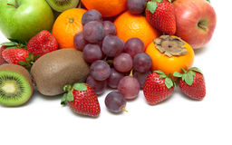 Ripe strawberries and other fruits closeup on a white background Stock Photography