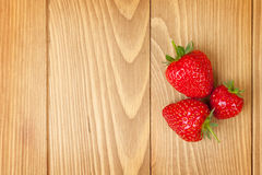 Ripe strawberries over wooden table background stock photo