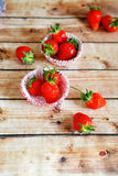 Ripe strawberries in paper muffin dish Royalty Free Stock Image