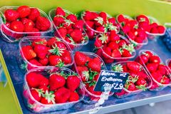 Ripe strawberries in plastic containers. Sale of berries royalty free stock image