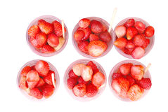 Ripe strawberries in plastic cup Stock Image