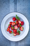 Ripe strawberries in a plate Stock Photos