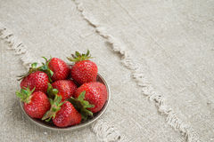 Ripe strawberries on a plate. Several large ripe strawberries on a plate Royalty Free Stock Image