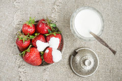 Ripe strawberries on a plate. Several large ripe strawberries with sour cream on a plate Stock Images