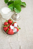 Ripe strawberries on a plate. Several large ripe strawberries with sour cream on a plate Stock Photo