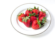 Ripe strawberries in a porcelain plate Royalty Free Stock Photo