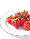 Ripe strawberries in a porcelain plate Royalty Free Stock Photos