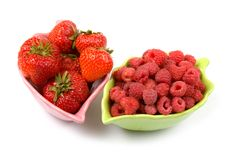 Ripe strawberries and raspberries Royalty Free Stock Images