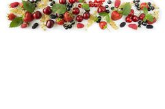 Ripe strawberries, redcurrants, blackcurrants, mulberries, raspberries and cherries on white background. Berries at border of image with copy space for text Royalty Free Stock Photo