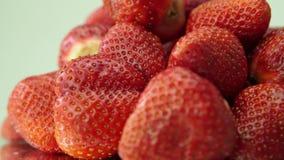 Ripe strawberries rotatin stock footage