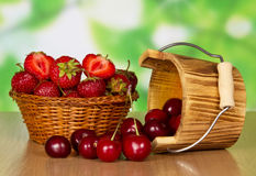 Ripe strawberries and sweet cherries Royalty Free Stock Photos