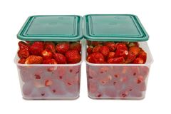 The ripe strawberries in two boxes with lids_1 Royalty Free Stock Photos