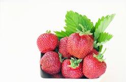 Ripe strawberries in a white bowl Stock Photo