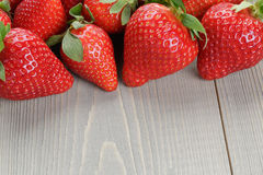 Ripe strawberries on wood table Stock Images