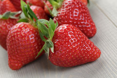 Ripe strawberries on wood table Stock Image