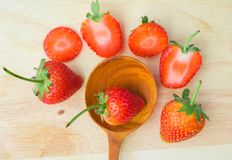 Ripe Strawberries. And a wooden spoon Royalty Free Stock Photo