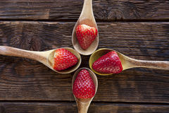 Ripe strawberries on wooden spoons. Royalty Free Stock Photos