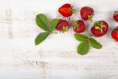 Ripe strawberries on a table stock images