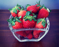 Ripe strawberries on a wooden table Stock Images