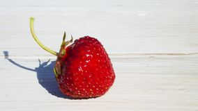Ripe strawberries. Ripe strawberries on a wooden table Stock Image