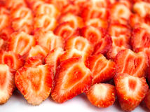 Ripe strawberry. Background from halves of a ripe strawberry Stock Images