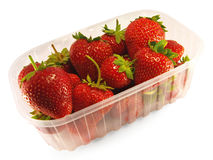 Ripe strawberry. In a transparent box. Isolated Stock Photos