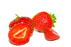 Ripe strawberry. Berries of a ripe strawberry, one of which is cut on a part Royalty Free Stock Images