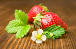 Ripe strawberry by close-up. On a wooden background Stock Photography
