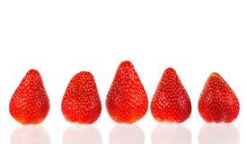 Ripe strawberry fruit on a white background. Royalty Free Stock Photos