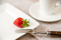 Ripe strawberry fruit on a white plate Royalty Free Stock Images