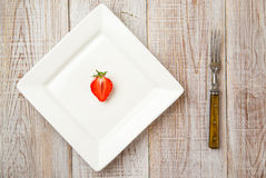 Ripe strawberry fruit on a white plate Stock Photo