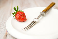 Ripe strawberry fruit on a white plate Royalty Free Stock Image