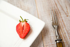 Ripe strawberry fruit on a white plate Royalty Free Stock Photography