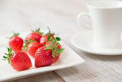 Ripe strawberry fruits on a white plate Royalty Free Stock Image