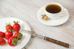 Ripe strawberry fruits on a white plate Royalty Free Stock Images