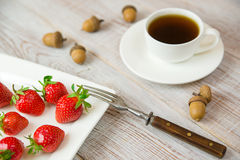Ripe strawberry fruits on a white plate Stock Images