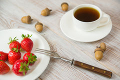 Ripe strawberry fruits on a white plate Stock Image