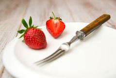 Ripe strawberry fruits on a white plate Stock Photos