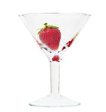 Ripe strawberry in glass isolated over white Royalty Free Stock Photo
