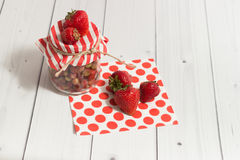 Ripe strawberry in jar on the wooden table Stock Image