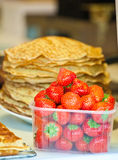 Ripe strawberry and pancakes on the counter Stock Photo