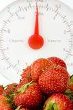 Ripe Strawberry's with Weight Scales. Shot against a plain background Stock Photo