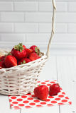 Ripe strawberry in white basket Stock Images