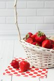Ripe strawberry in white basket Royalty Free Stock Images