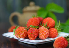 Ripe strawberry on a white plate. Stock Photo
