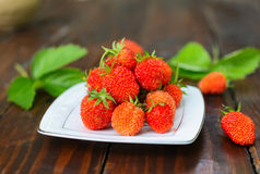 Ripe strawberry on a white plate. Stock Image
