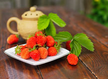 Ripe strawberry on a white plate. Royalty Free Stock Photos