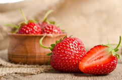 Ripe Strawberry in a wooden Bowl Royalty Free Stock Photo